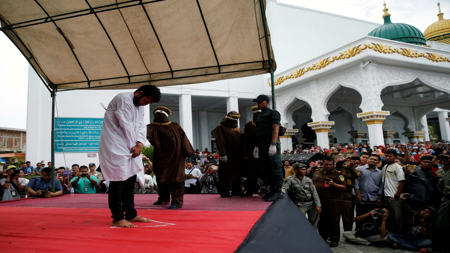 two gays caned in indonesia