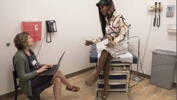 Nurse practitioner Caroline Cylkowski (left) examines Solorah Singleton, 36, of Philadelphia at Mazzoni Center, a care facility for LGBTQ patients in Philadelphia. Singleton was born male but identifies as female. She has been undergoing hormone therapy for six to seven years and is hoping for breast augmentation surgery soon.