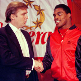 Then-New Jersey Generals owner Donald Trump shakes hands with Herschel Walker