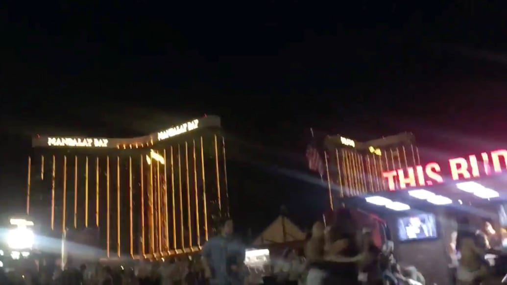 People run outside the Mandalay Bay Hotel after a gunman opened fire on attendees of the Route 91 Harvest Music Festival in Las Vegas, U.S., October 1, 2017 in this still image obtained from social media video.