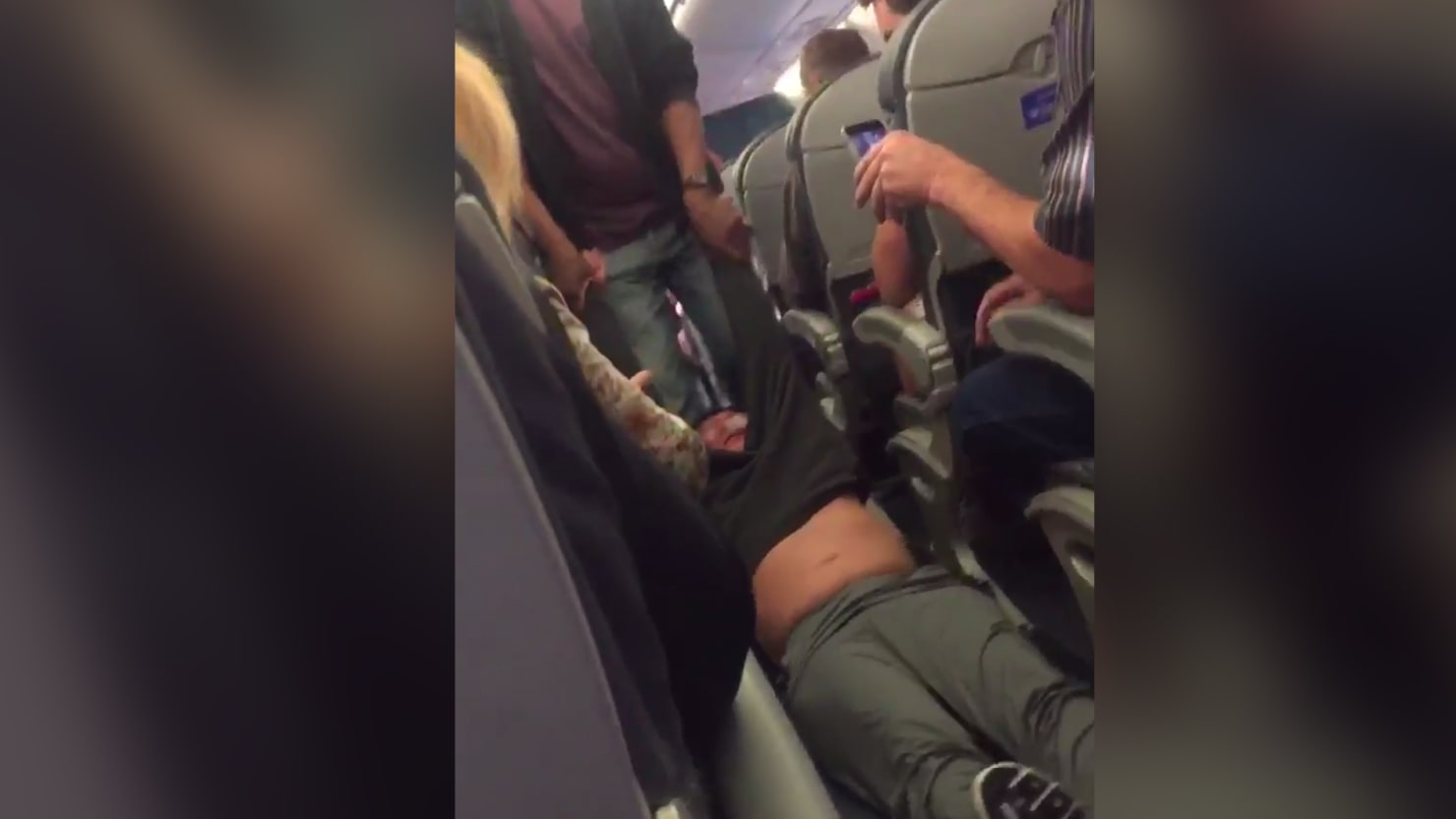 Horrifying Video Shows a Man Being Dragged Off an Overbooked United Airlines Flight