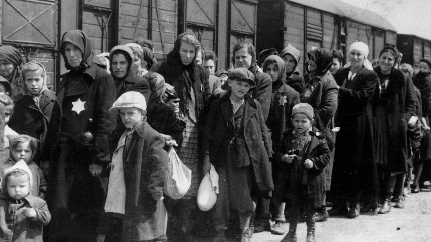 an overview of the lodz ghetto in europe during the world war two in poland Shows the efforts of german-appointed leader chaim rumkowski to save the jewish community during the nazi occupation of lodz, poland, in world war ii documents rumkowski's establishment of an entire society, including schools, industries, and a postal system.