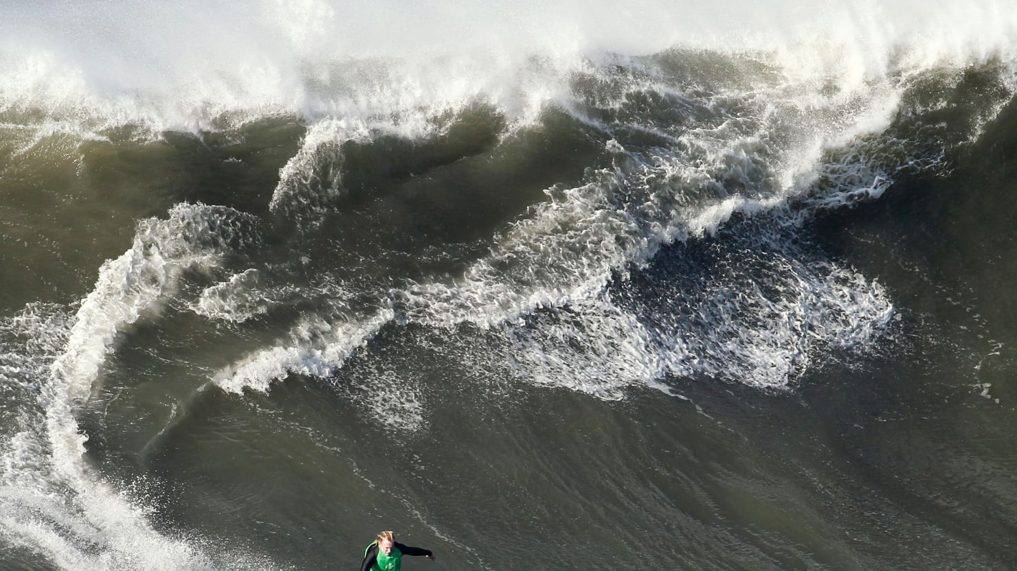 Surfer Rides 100 Foot Wave