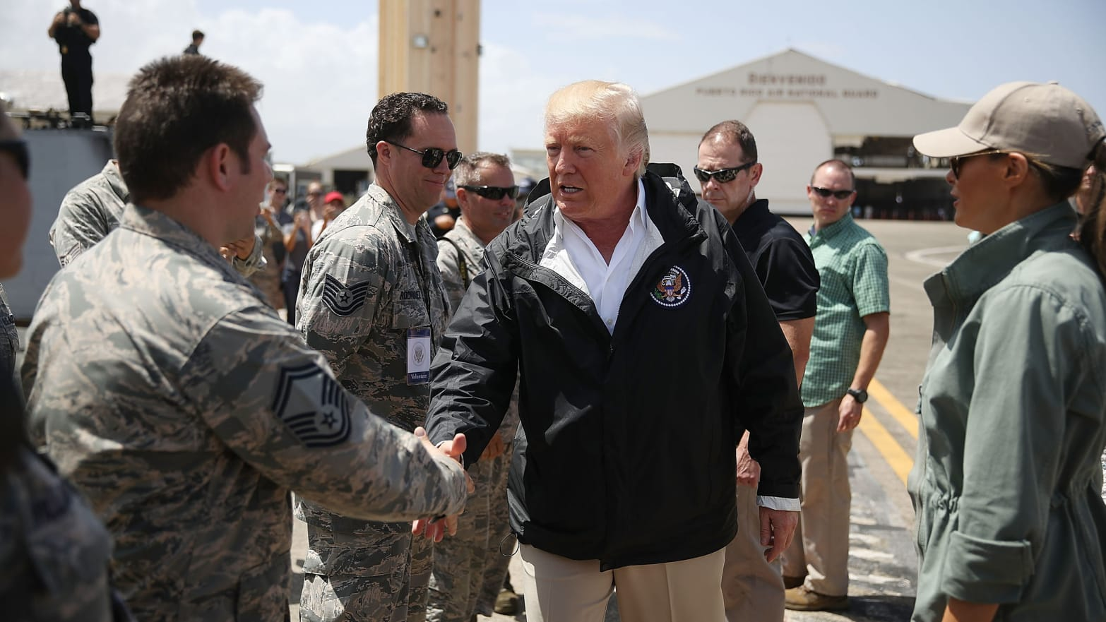 CAROLINA, PUERTO RICO - OCTOBER 03: US President Donald Trump greets U.S Air Force airmen as he arrives at the Muniz Air National Guard Base as he makes a visit after Hurricane Maria hit the island on October 3, 2017 in Carolina, Puerto Rico.