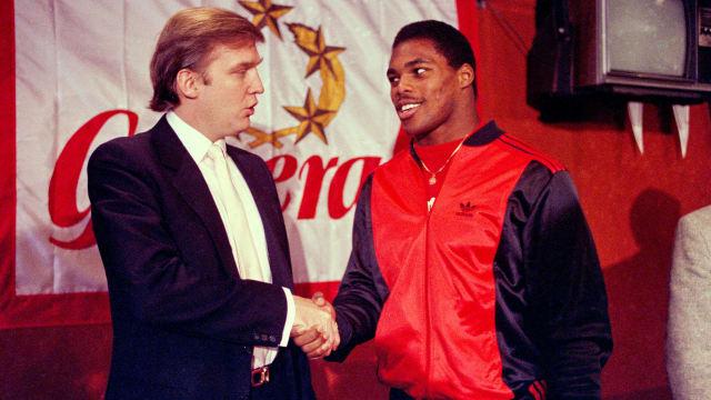 Then-New Jersey Generals owner Donald Trump shakes hands with Herschel Walker
