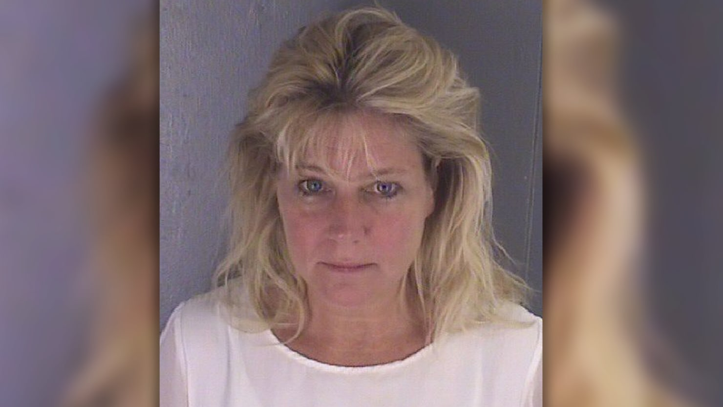Teresa Jo Burchfield, wife of a lawyer in charge of overseeing ethics in President Trump's business trust was arrested outside a Virginia jail—with an inmate in her backseat.