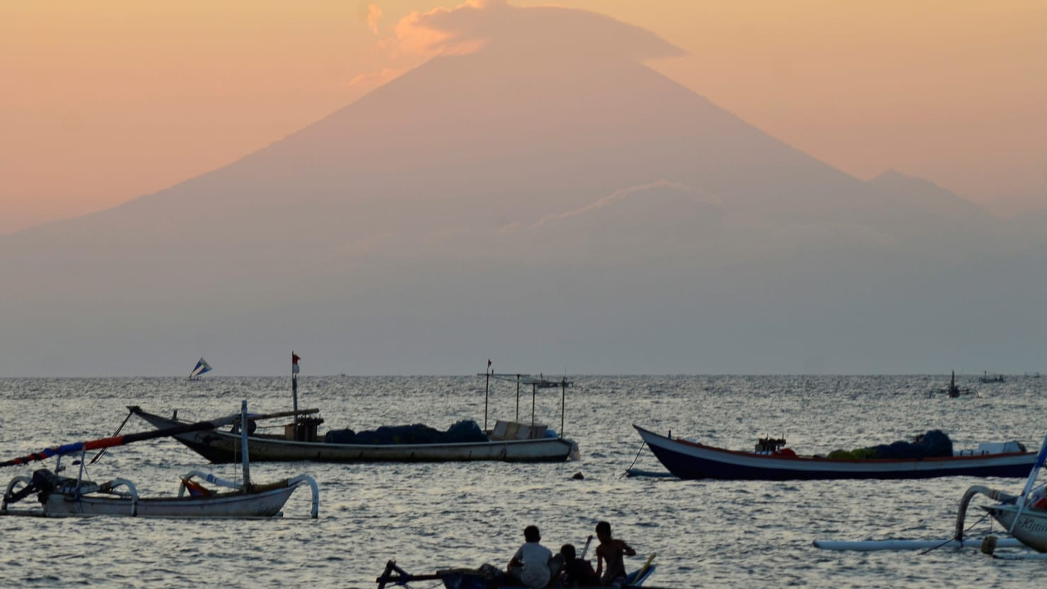 Tremors from Mount Agung have led Indonesian scientists to believe it may erupt for the first time in more than 50 years, forcing residents out amid heightened travel warnings.