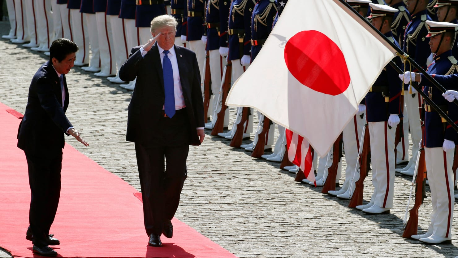 U.S. President Donald Trump reviews an honor guard during a welcome ceremony with Japanese Prime Minister Shinzo Abe at Akasaka State Guest House in Tokyo, Monday, Nov.6, 2017.