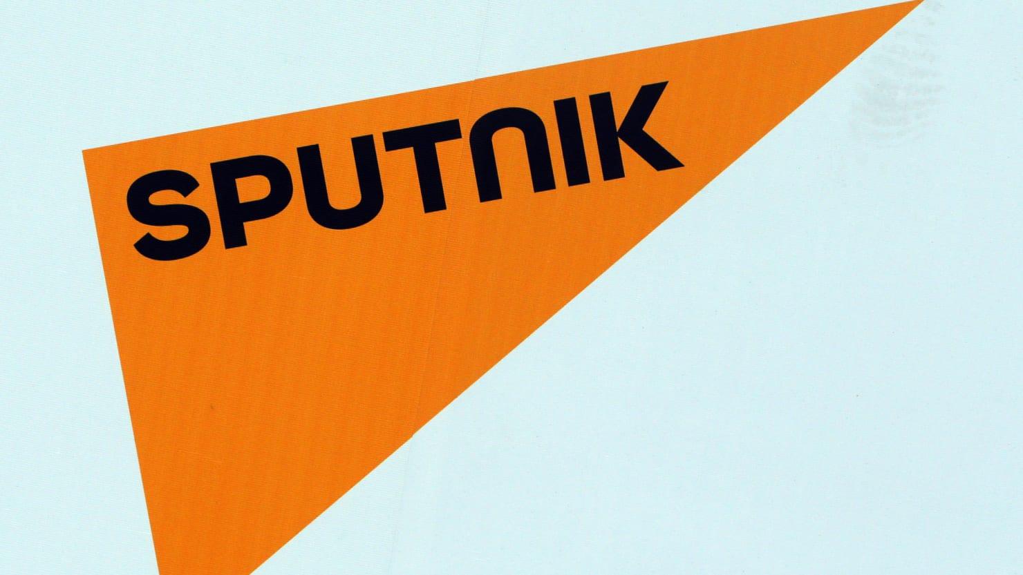 The logo of Russian state news agency Sputnik is seen on a board at the St. Petersburg International Economic Forum 2017 (SPIEF 2017) in St. Petersburg, Russia, June 1, 2017. Picture taken June 1, 2017. REUTERS/Sergei Karpukhin - RC17834DEB30
