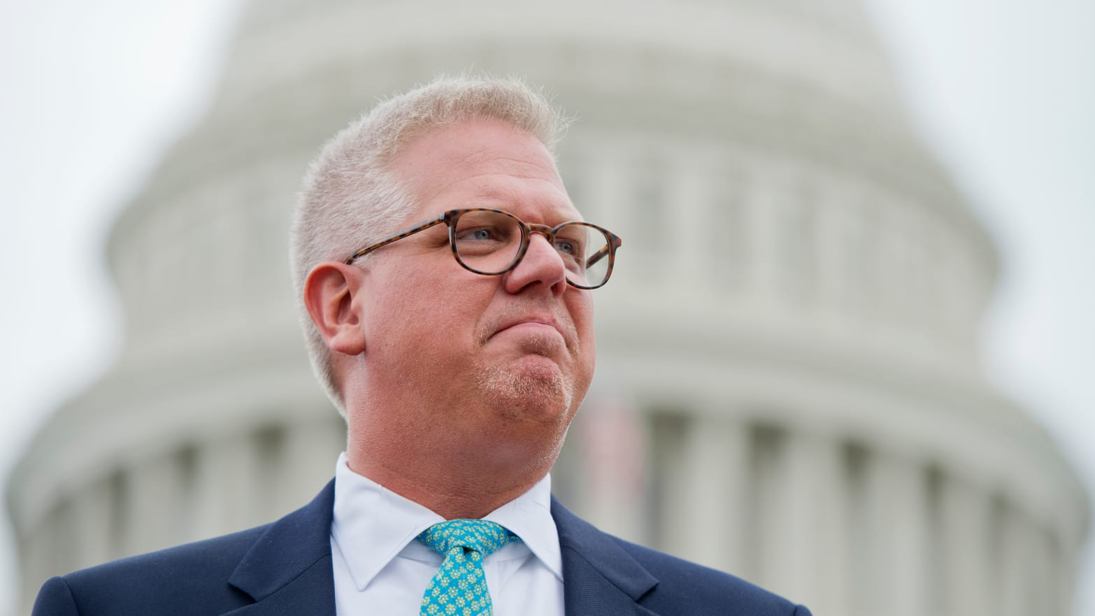Conservative talk show host Glenn Beck attends a Tea Party Patriots rally on the west front of the Capitol to protest the IRS's targeting of conservative political groups.