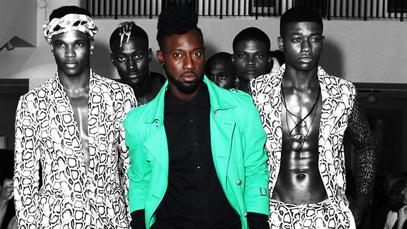 Menswear designer Dexter Pottinger (C) poses on the runway.