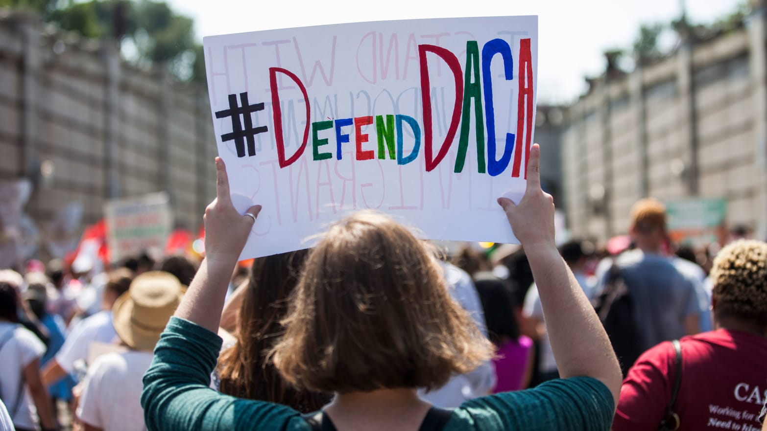 Demonstrators march during a demonstration in response to the Trump Administration's announcement that it would end the Deferred Action for Childhood Arrivals (DACA) program
