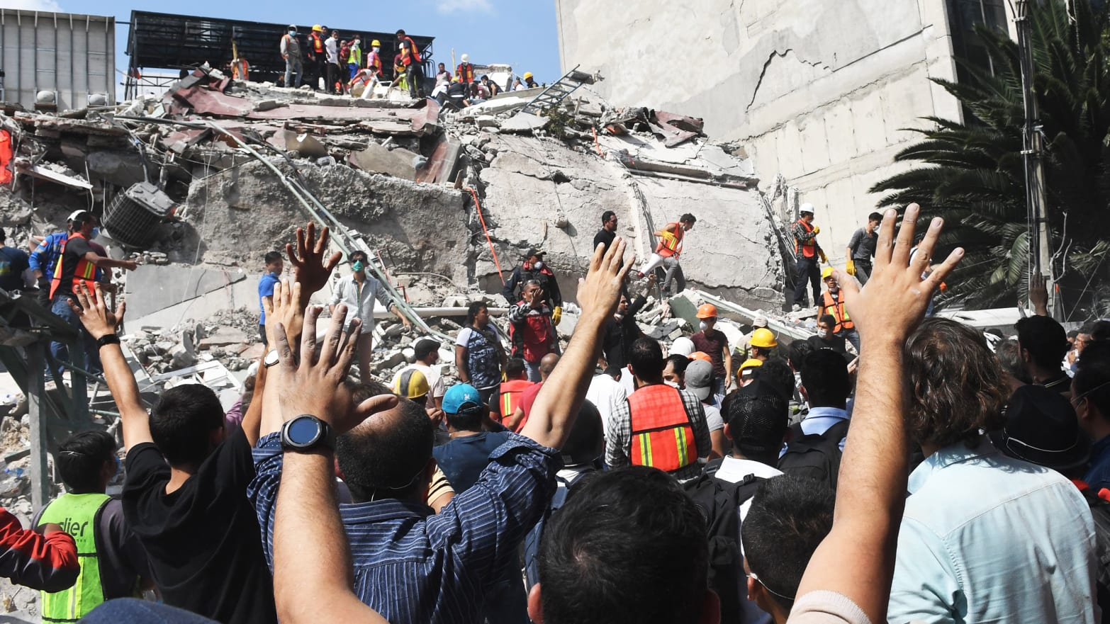 Rescuers search for survivors amid the rubble of a collapsed building after a powerful quake in Mexico City