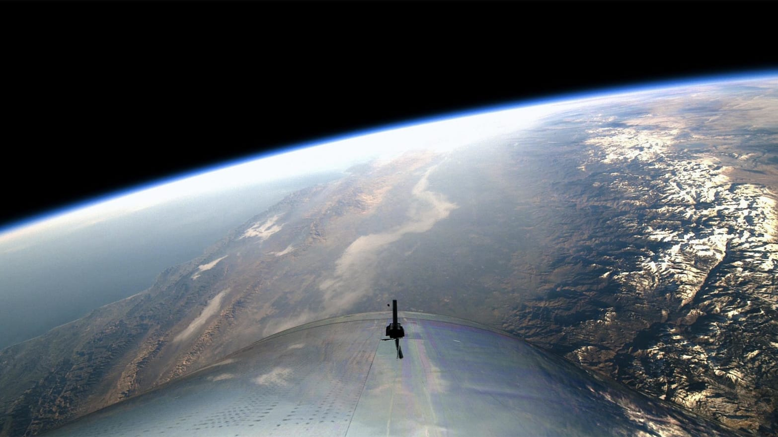 image of spaceshiptwo floating over earth virgin galactic richard branson space vacation elon musk big fucking rocket accident death
