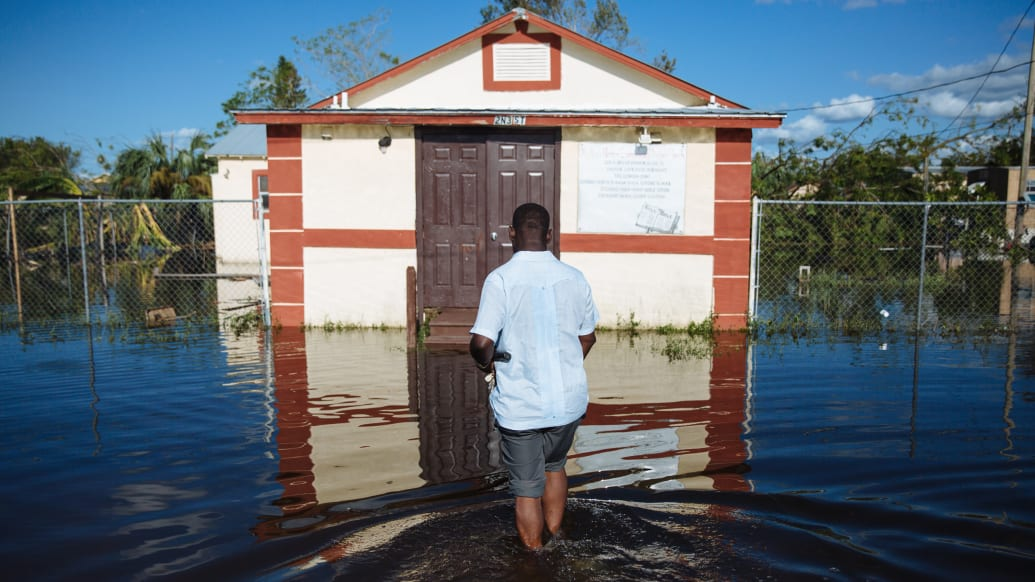 Immokalee, United States: Hurricane Irma. Louicesse Dormaint, Pastor of Haitian United Evangelical Mission in Immokalee outside his church.