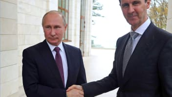 Russia's President Vladimir Putin (L) shakes hands with his Syrian counterpart Bashar al-Assad during a meeting in Sochi on November 20, 2017.