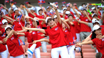 North Korean cheerleaders show support for North Korea in their football match against South Korea during the 2015 EAFF E-1 Football Championship in Wuhan city, China on August 9, 2015.
