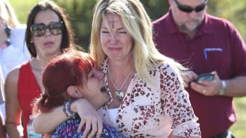 Parents wait for news after a reports of a shooting at Marjory Stoneman Douglas High School in Parkland, Fla., on Wednesday, Feb. 14, 2018.