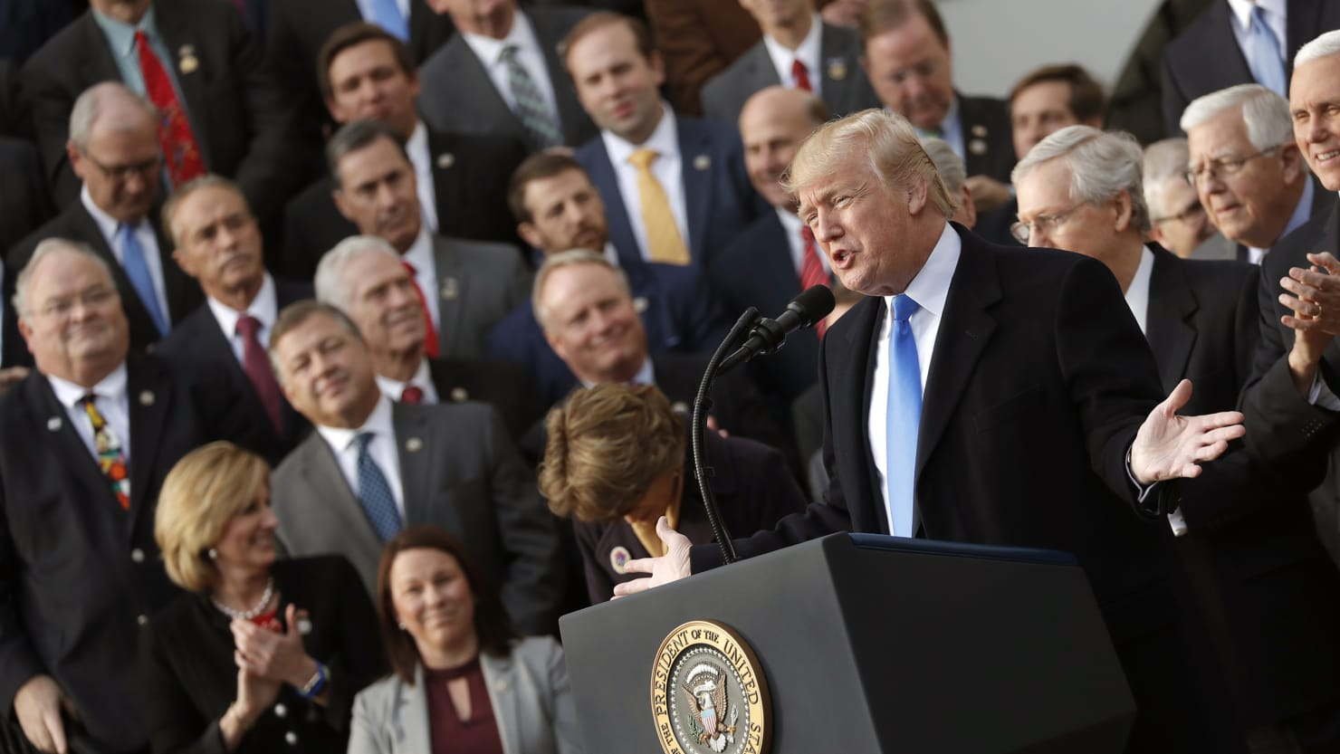 U.S. President Donald Trump celebrates with Congressional Republicans after the U.S. Congress passed sweeping tax overhaul legislation, on the South Lawn of the White House in Washington, U.S., December 20, 2017.