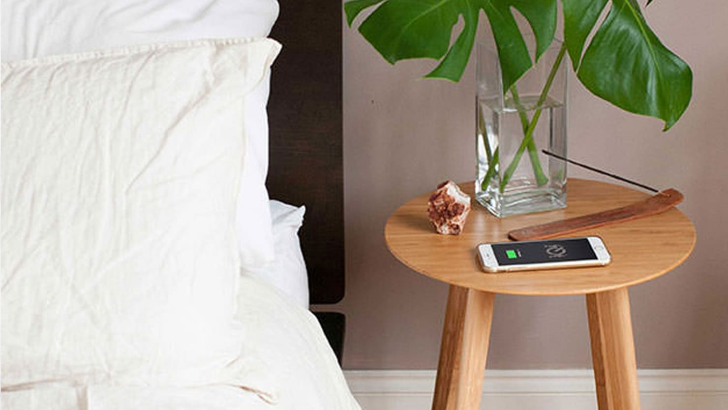 A Bamboo Side Table That Magically Charges Your Phone Is 25% Off