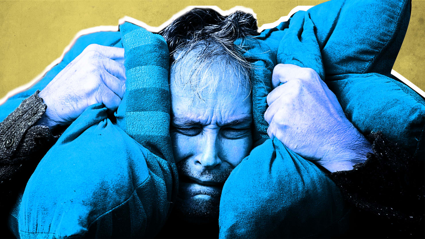 man colored in blue is in angst and holding two pillows by each ear