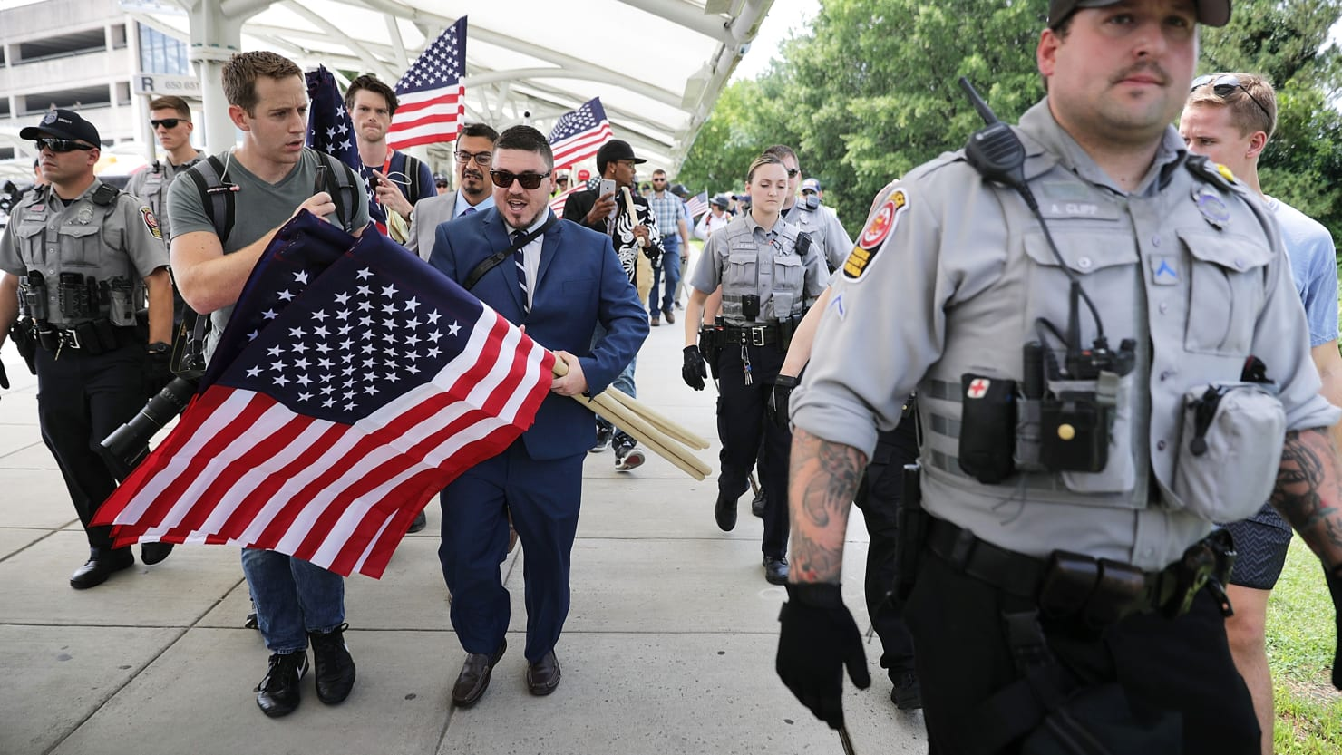 Surrounded by thousands of protesters, White nationalists slither home