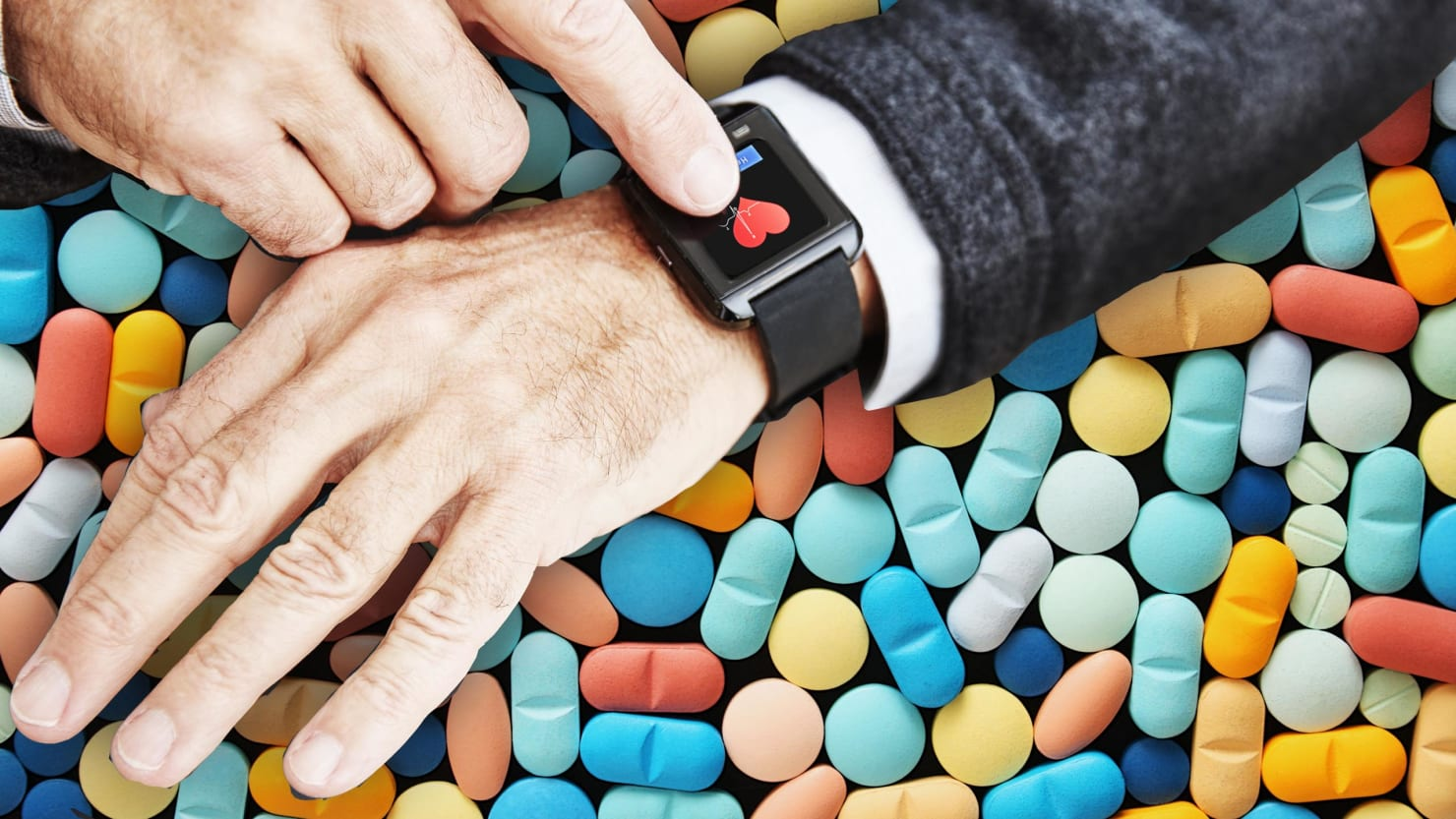 photo of hand with fitbit fit bit showing heart over tablets and pills john hancock insurance company west virginia life health fitness tracker