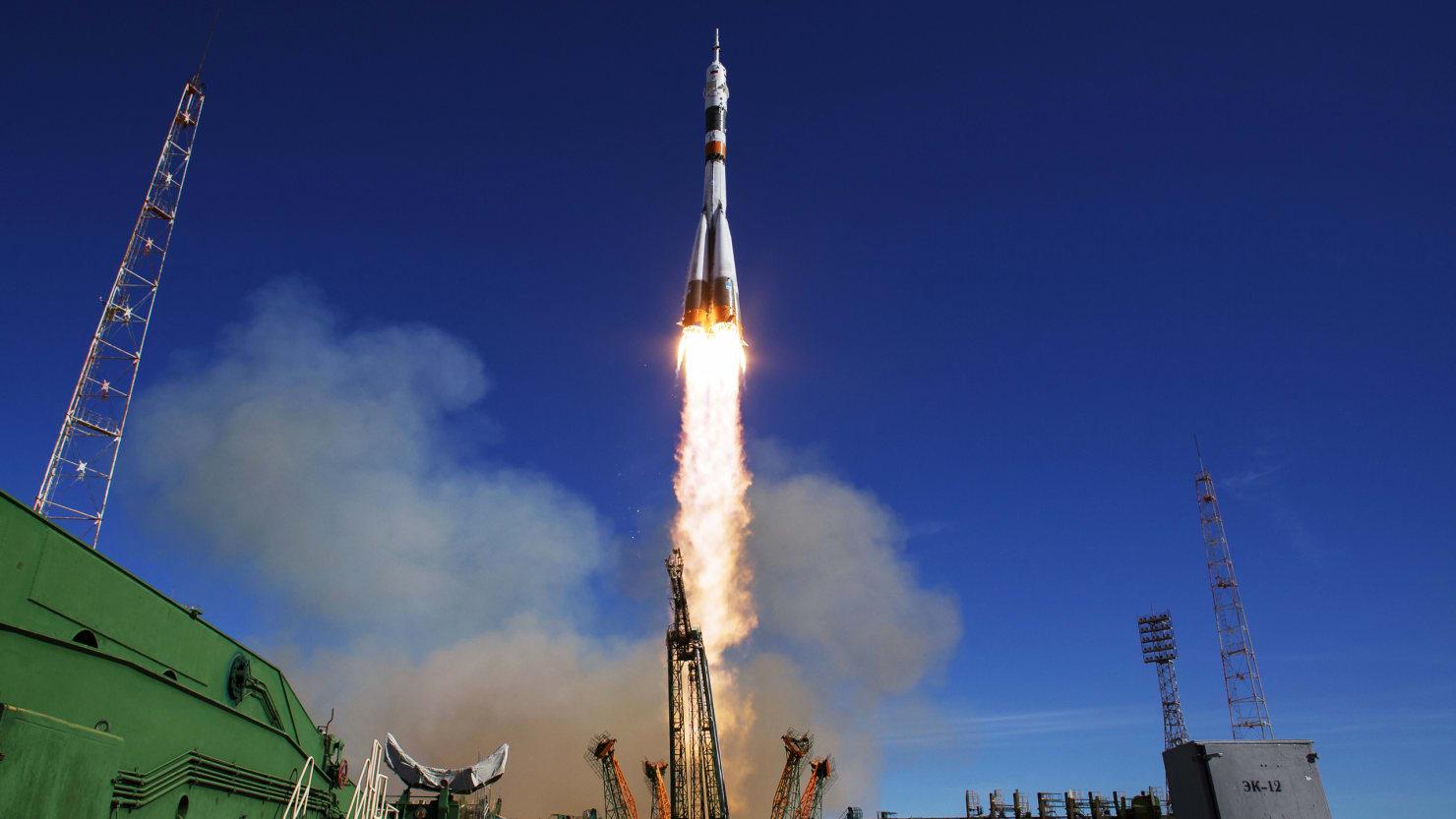 image of soyuz rocket taking off from kazakhstan into sky roscosmos russia united states america nasa