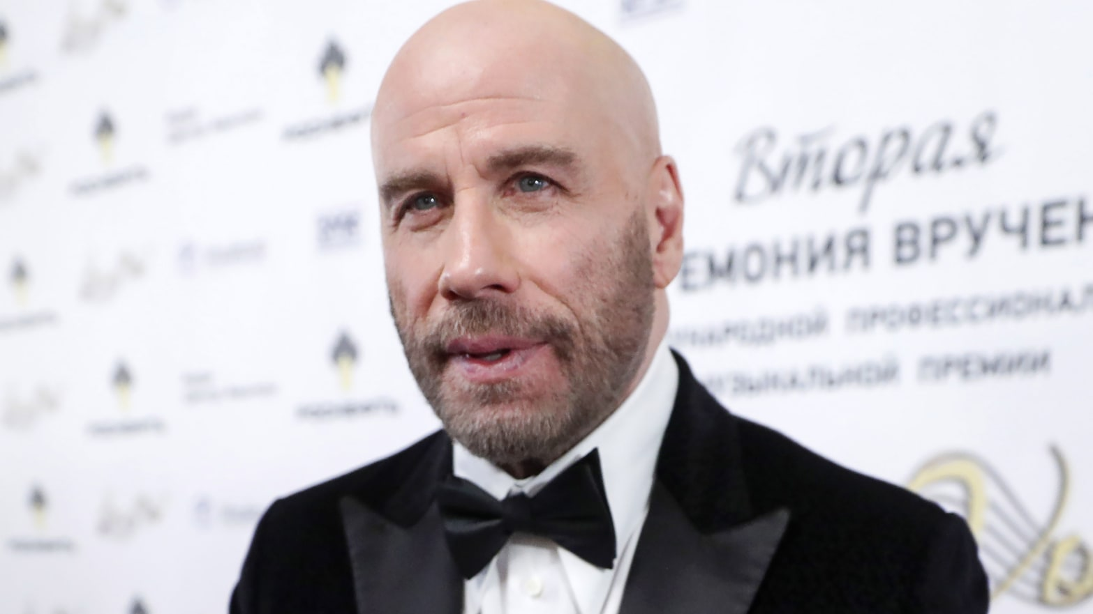 Why Is John Travolta Palling Around With Putin's Cronies in Russia?