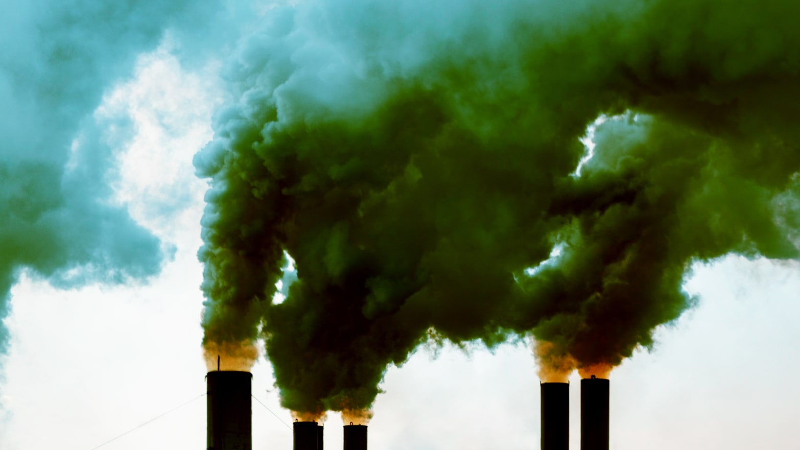 image of plumes of smoke coming out of factory carbon dioxide emissions pollution co2 trump gina loudon fake psychologist psychology phd envirowhacked environment