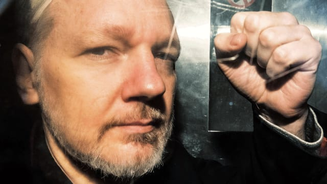 Trump charges Assange with publishing