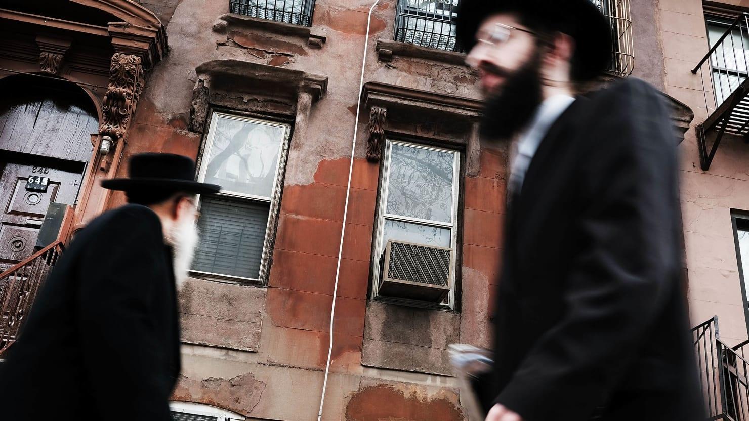 hasidic men walking through a jewish orthodox neighborhood in williamsburg brooklyn measles mmr vaccine anti vaxxer vaccination