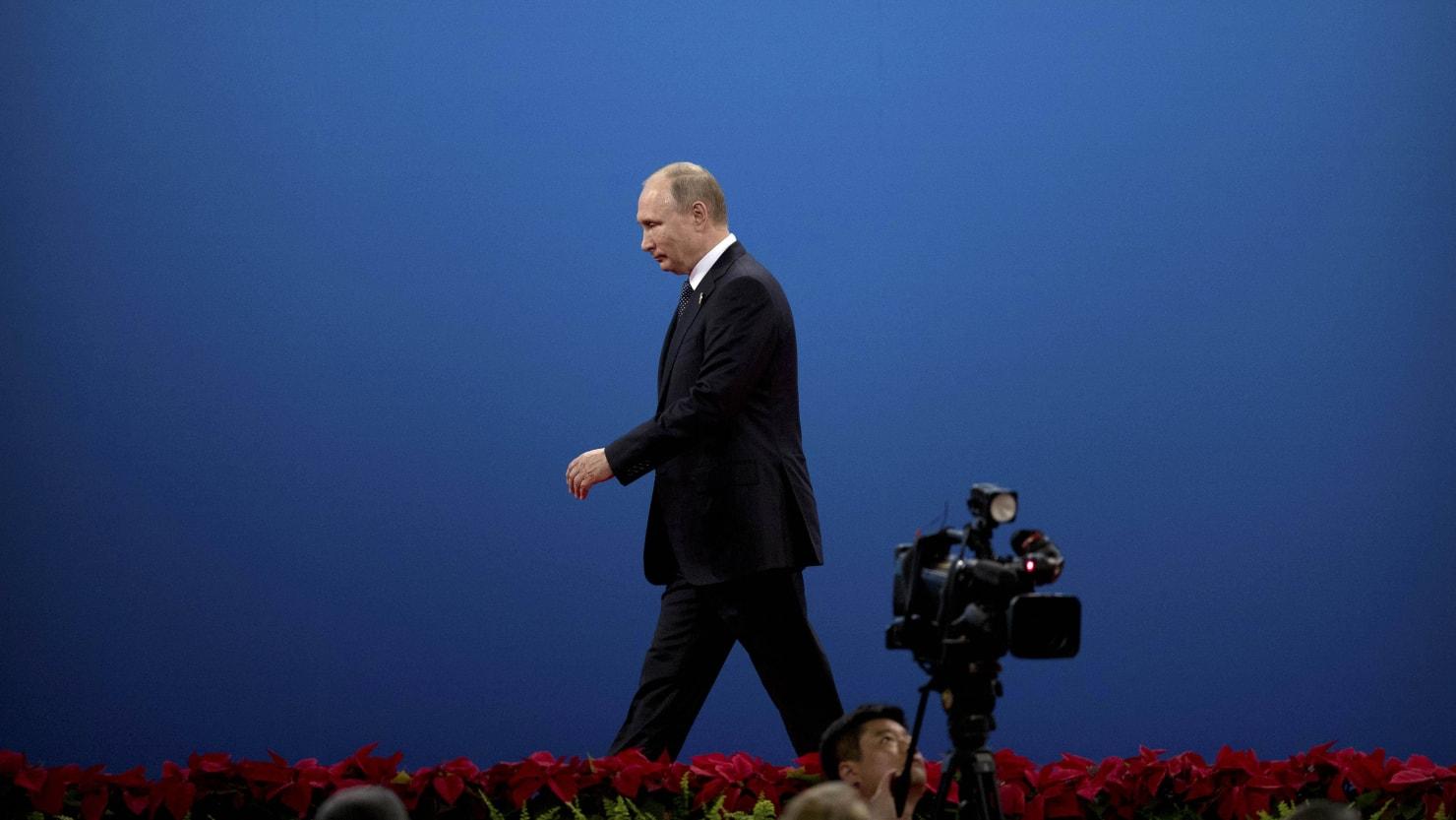 Putin Ramps Up RT's Propaganda Budget as Poll Rating Slumps