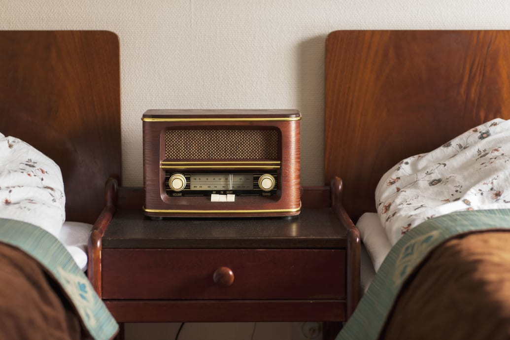 Two vintage twin beds with a radio between them