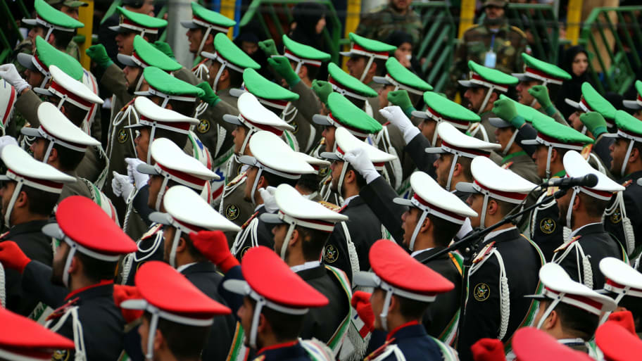 Iranian guards march during celebrations in Tehran's Azadi Square (Freedom Square) to mark the 37th anniversary of the Islamic revolution on February 11, 2016.