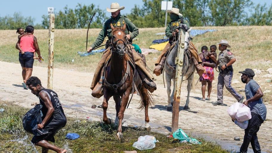 """Border Patrol Agent on Horseback Filmed Whipping Haitian Asylum Seekers on Rio Grande; Biden Administration Calls Action """"Horrific"""""""