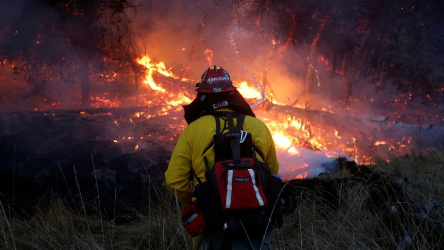 Firefighters battle a wildfire near Santa Rosa, California, U.S., October 14, 2017.