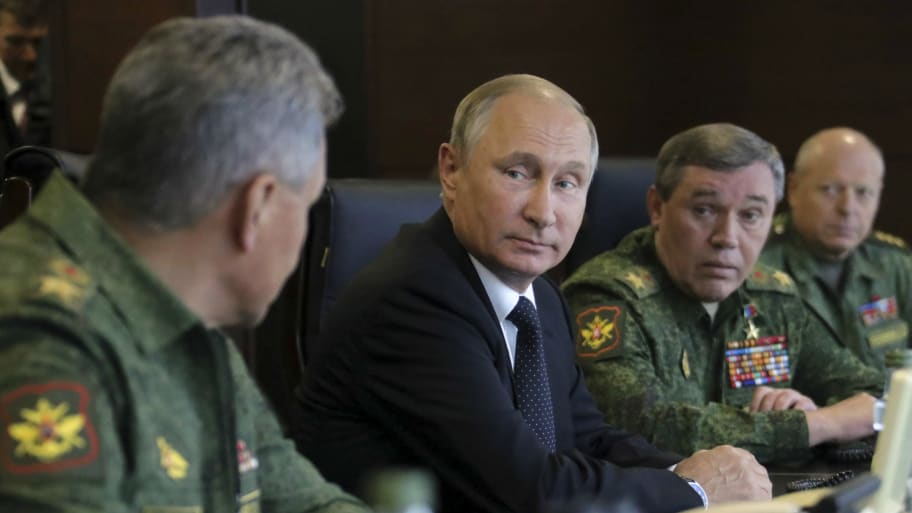 Russian President Vladimir Putin (2nd L), Defence Minister Sergei Shoigu (L) and Chief of the General Staff of Russian Armed Forces Valery Gerasimov (2nd R)