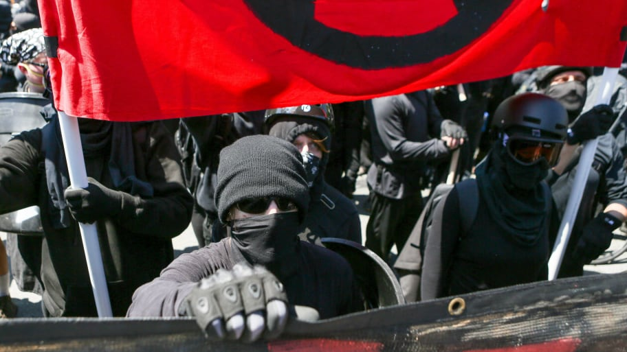 Antifa members and counter protesters gather during a rightwing No-To-Marxism rally on August 27, 2017 at Martin Luther King Jr. Park in Berkeley, California.