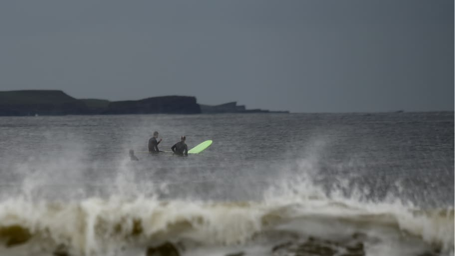 Surfers wait in the Atlantic on their surfboard for big waves to hit on the eve of storm Ophelia in the County Clare town of Lahinch, Ireland October 15, 2017.