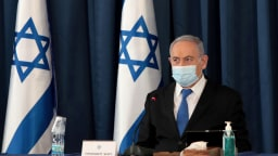 FILE PHOTO: Israeli Prime Minister Netanyahu wears a protective mask, amid the spread of the coronavirus disease (COVID-19), as he holds a weekly cabinet meeting at the Foreign Ministry in Jerusalem, July 5, 2020.