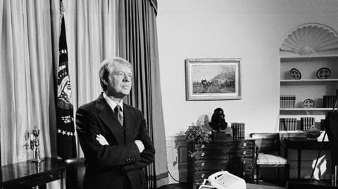 jimmy carter oval office. jimmy carter stands behind his desk in the oval office of white house moments before addressing nation on, monday, april 18, 1977. a