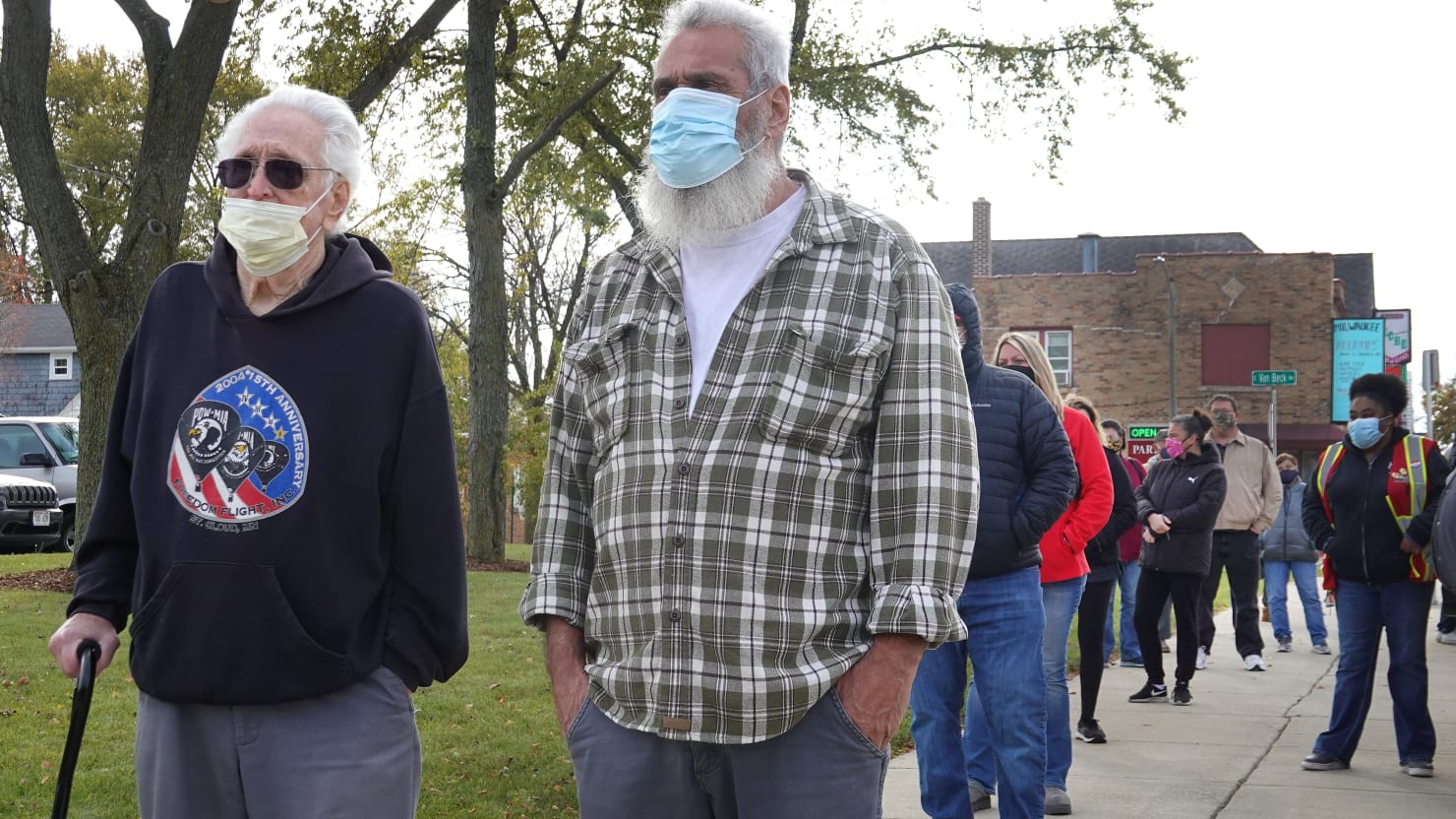 Coronavirus Is Surging in Wisconsin. People Are Early Voting in Force Anyway.