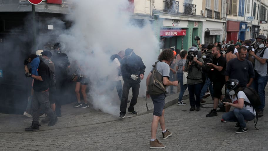 French Police Use Tear Gas and Water Cannons on G7 Protesters