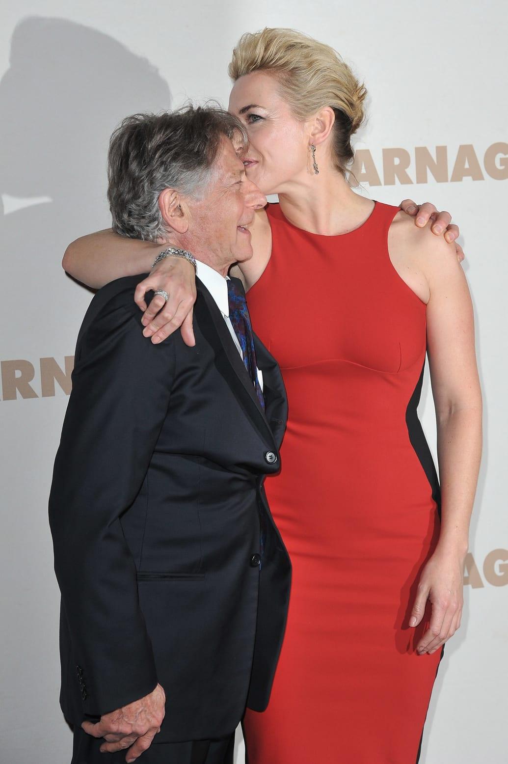 "PARIS, FRANCE - NOVEMBER 20:  Roman Polanski and Kate Winslet (R) attend ""Carnage"" Paris premiere at Cinema Gaumont Marignan on November 20, 2011 in Paris, France.  (Photo by Pascal Le Segretain/Getty Images)"