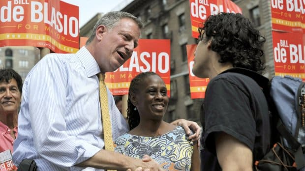 Bill de Blasio greets voters on the Upper West Side along with his wife, Chirlane McCray, on September 10.