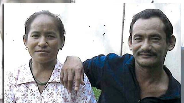 This undated photo provided by the Philadelphia District Attorney's Office shows Karnamaya Mongar and her husband.