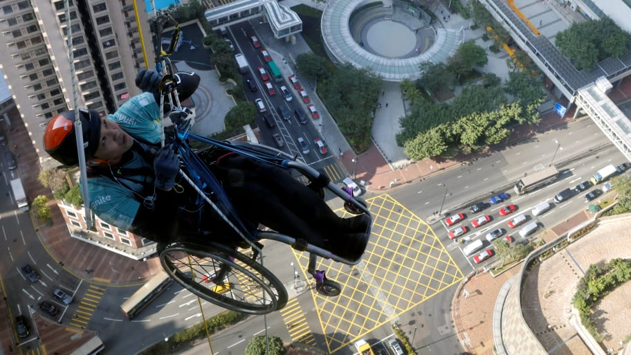Wheelchair Climber Scales Hong Kong Skyscraper for Charity