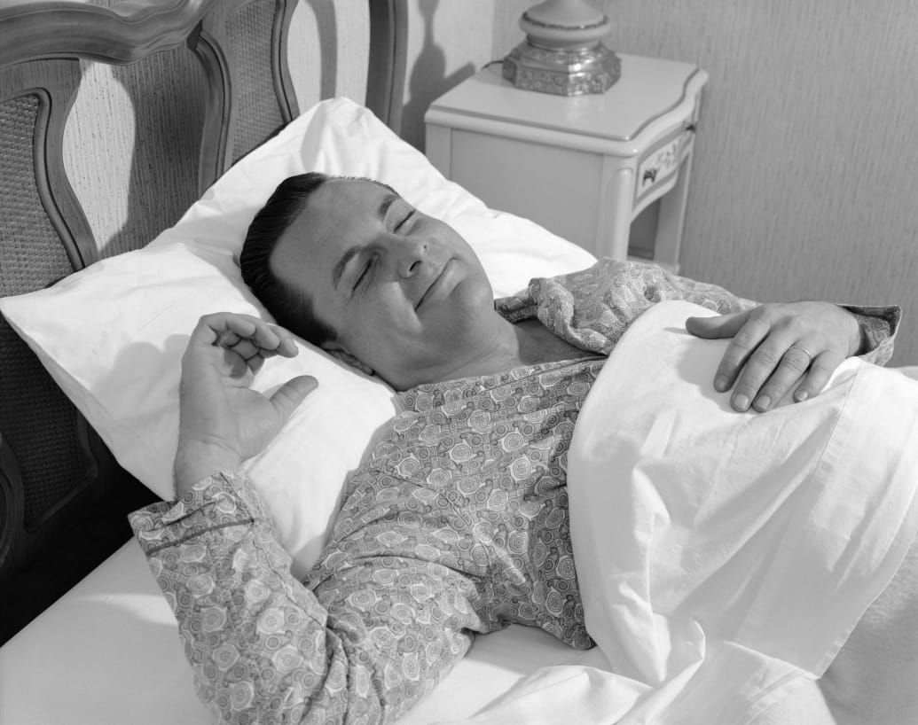 UNITED STATES - CIRCA 1960s:  Man in bed, in tranquil sleep.
