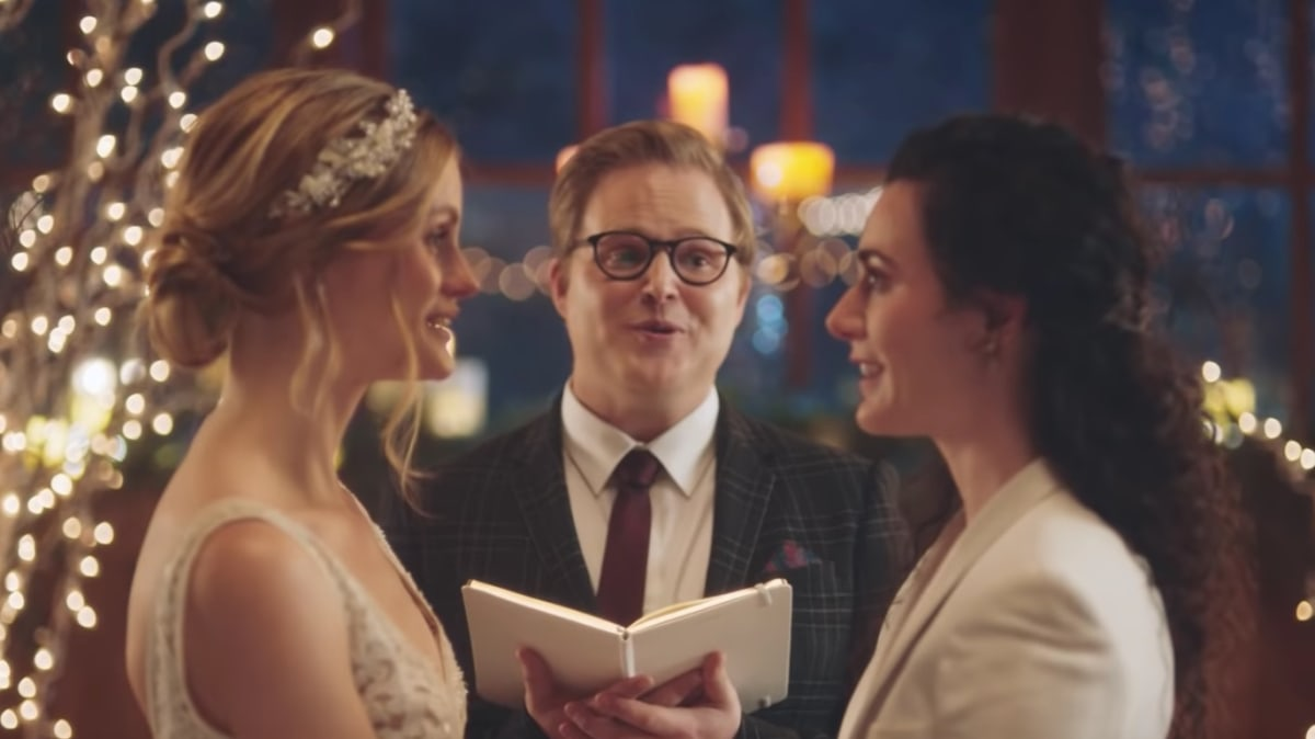 Zola Fights Back After Hallmark Channel Pulls Lesbian Wedding Ads